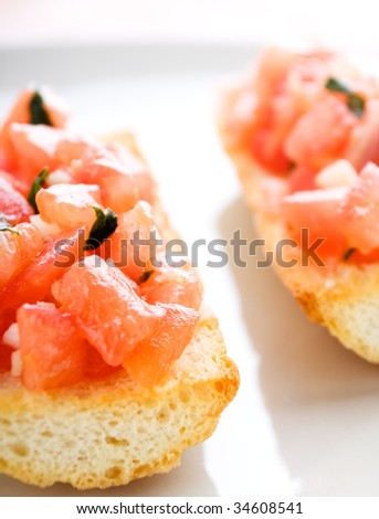 Toasted bruschetta with tomatoes, garlic and basil