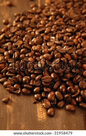 Toasted coffee beans texture under golden light
