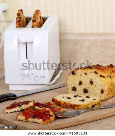 Toasted raisin bread with jam on a kitchen counter - stock photo