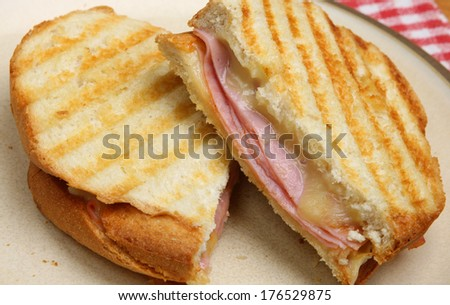 Toasted sandwich with ham and cheese.