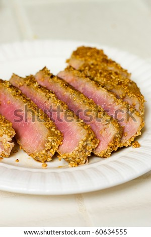 Toasted Sesame Crusted Rare Ahi Tuna Sliced and Ready to Enjoy - stock photo