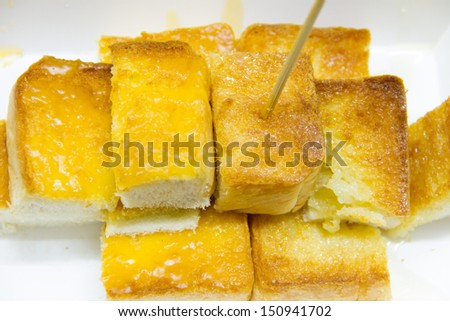 Toasted white bread with orange marmalade on white box - stock photo