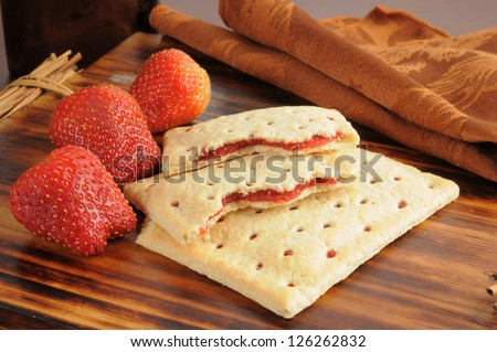 Toaster pastries filled with fresh strawberries - stock photo