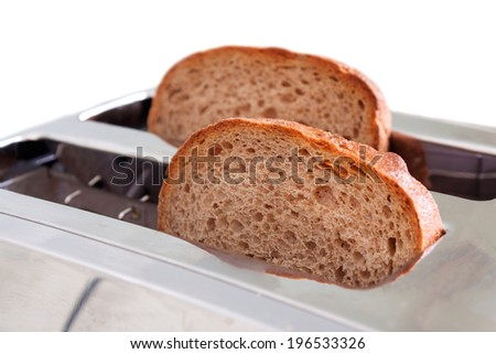Toaster with brown bread on white background. - stock photo