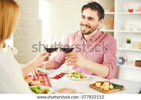 Toasting at dinner - stock photo
