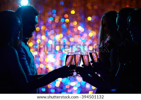 Toasting at party - stock photo