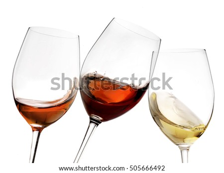 Toasting gesture red and white wine with splash, cheers close up with wine isolated
