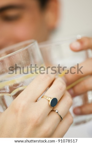 Toasting glasses, close-up - stock photo