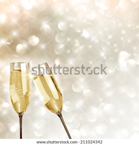 Toasting with champagne glasses very festive background - stock photo