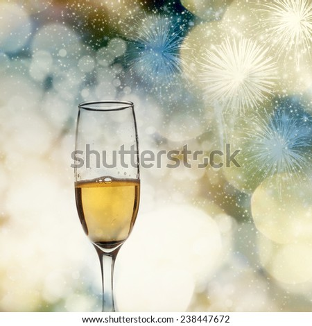 Toasting with two champagne glasses against holiday lights and fireworks - stock photo