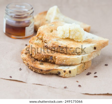 Toasts with honey and parmesan - stock photo