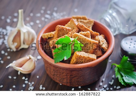 toasts with salt and garlic - stock photo