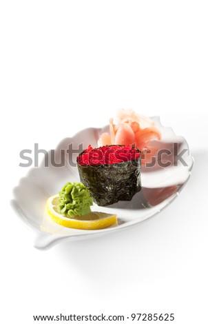 Tobiko Gunkan Sushi (Flying Fish Roe) Garnished with Ginger and Wasabi - stock photo
