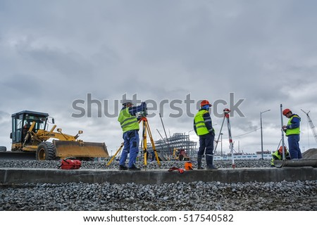 Tobolsk, Russia - July 15. 2016: Sibur company. Construction of plant on processing of hydrocarbons. Surveyor builders worker with theodolite transit equipment outdoors during surveying work
