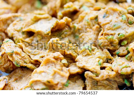 Tod Mun Thai Food fried fish mix herbs and red curry - stock photo