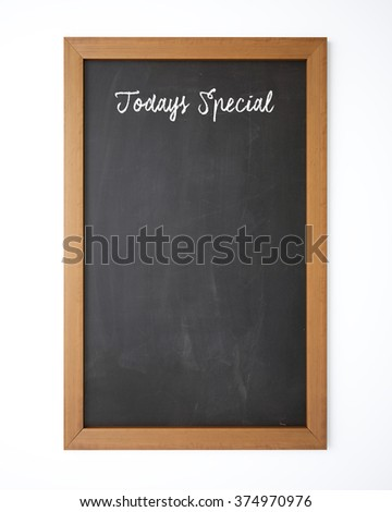 Today's Special written with chalk on a blackboard. Isolated on white background. The blackboard has dirty chalk texture. Great use for menus and announcements. - stock photo
