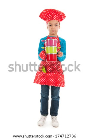 Toddler boy as cook is helping mother isolated over white background