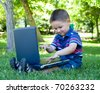 toddler boy playing with laptop - stock photo