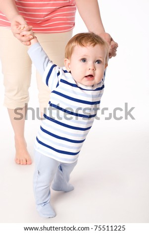 Toddler boy trying to make a step - stock photo