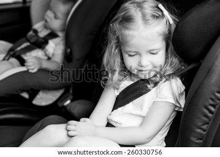 Toddler cute kids in car seats summer  ( black and white ) - stock photo