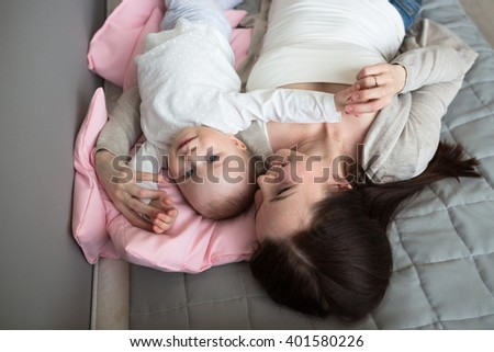 toddler daughter and mother are happy together, Funny playful mum with baby toddler at home - stock photo