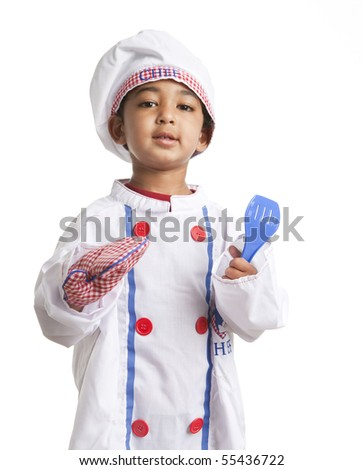 Toddler Dressed as a Chef Holding a Spatula and Oven Mitt - stock photo