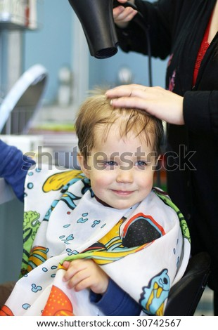 Toddler getting a haircut - stock photo