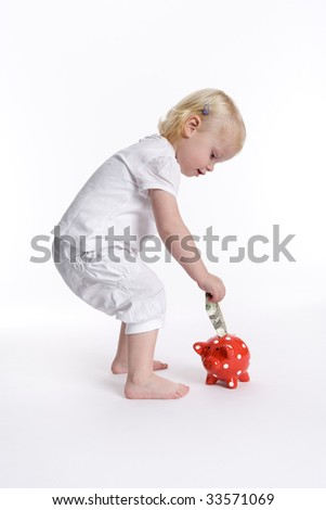 Toddler girl is saving dollars for the future - stock photo