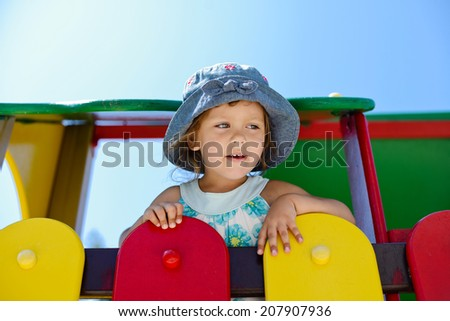 toddler girl on the playground in summer