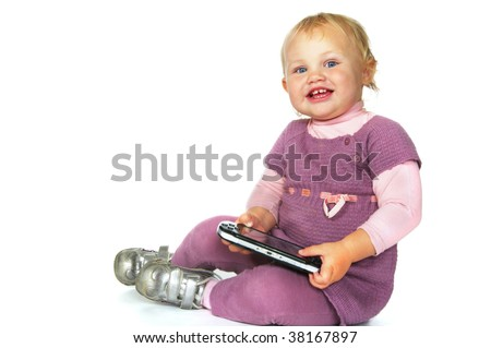toddler girl with psp sitting - stock photo