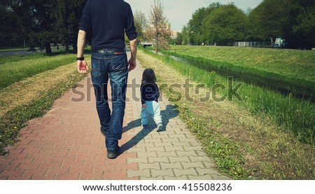 Toddler is walking with a parent exploring world