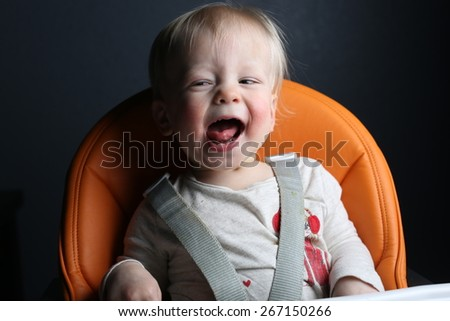 Toddler laughing  - stock photo