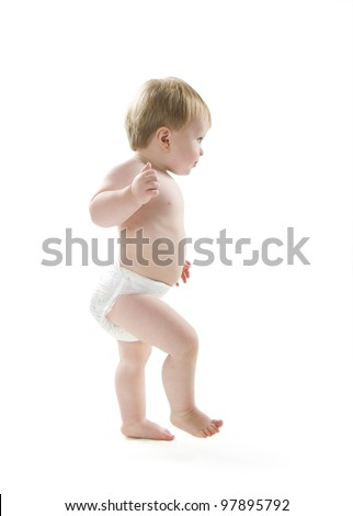 Toddler learning to walk - stock photo
