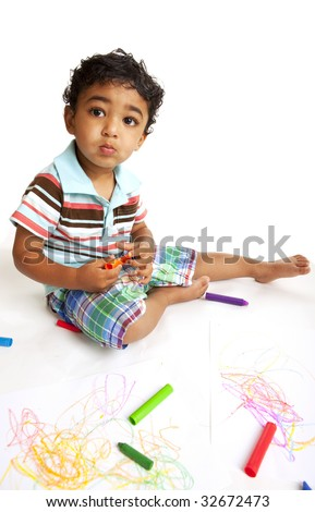 Toddler Playing with Crayons on White