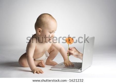 Toddler playing with laptop