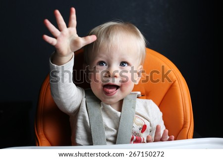 Toddler raising hand - stock photo