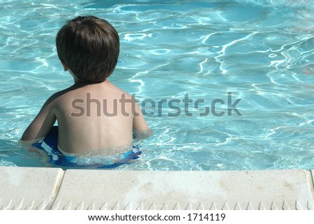 Toddler Sitting on Edge of Pool
