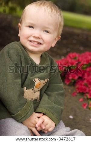 Toddler smiling for the camera - stock photo