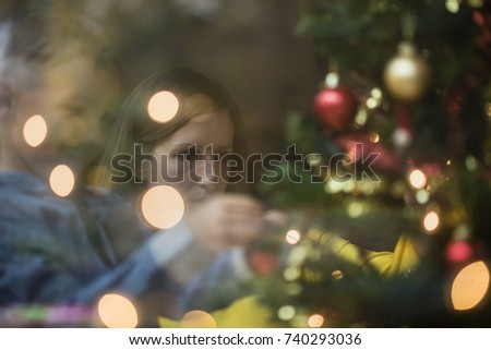 decorating with christmas rear view young boy decorating christmas stock photo 739807660