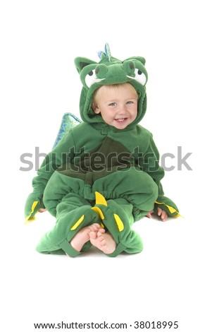 Toddler wears a cute dragon costume. Halloween Theme - stock photo