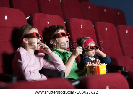 Toddlers in the movie side view - stock photo
