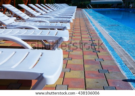 TODIRESTIi, MOLDOVA - JUNE 16, 2016: Relax and sunbathe by pool with clear blue water in SV club hotel Village. Swimming pool in village. Todiresti, Moldova