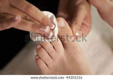 toes being cleaned during pedicure