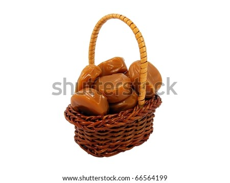 Toffee Sweets in a Wicker Basket - stock photo