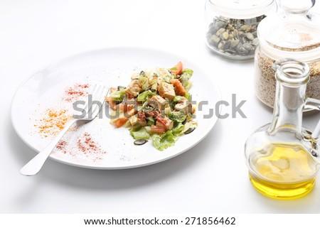 Tofu and vegetables salad. Olive oil, pumpkin and sesame seeds. White ...
