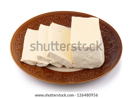 Tofu cubes on plate isolated on white background - stock photo
