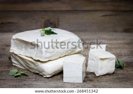 tofu isolated on wooden. - stock photo