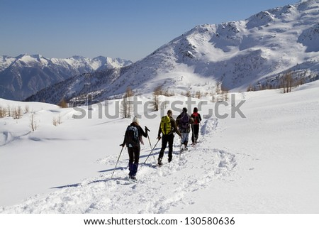 together in the snow - stock photo