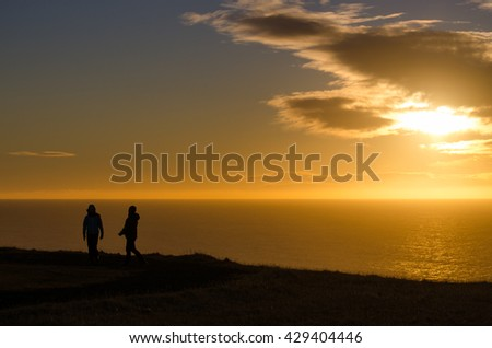 Together loves at Sunrise on the sea and beautiful sky for nature background - stock photo