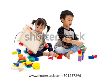 together playing colorful wooden bricks and plastic blocks